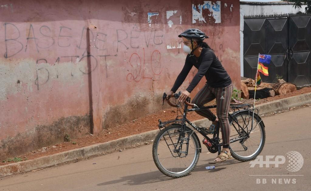 自転車で世界旅行中の韓国人男性、ギニアで足止め 差別に遭遇も続行へ意欲