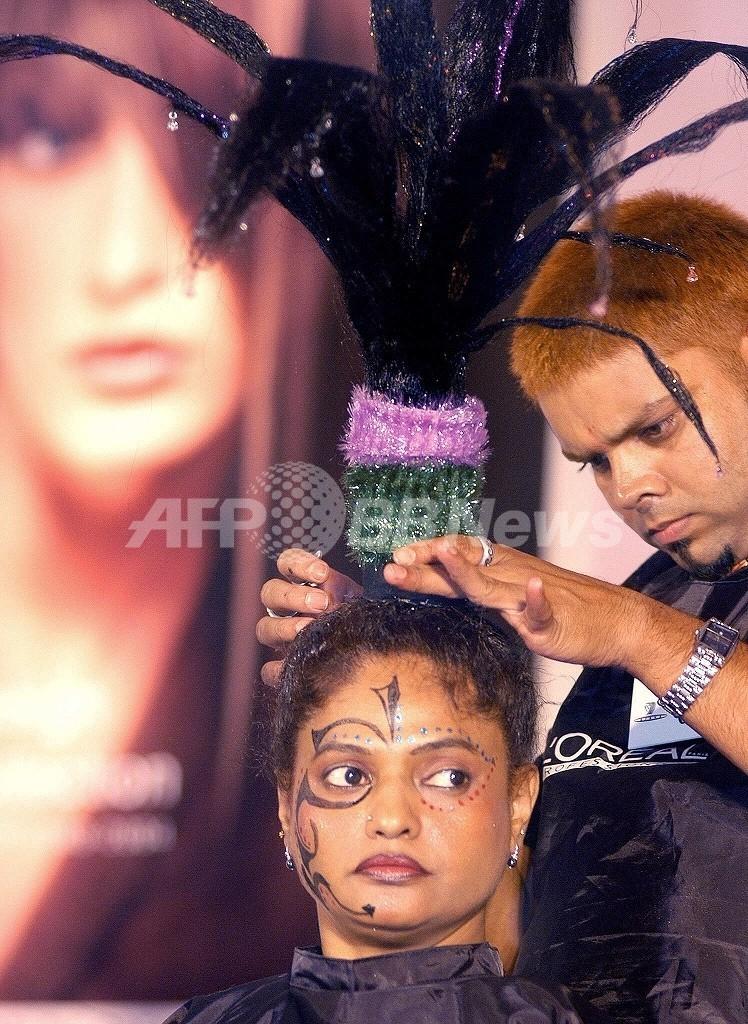 美容師はがんリスクが高い可能性、WHO報告