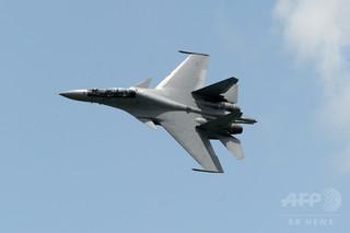 中国、東シナ海での米軍機への妨害を否定