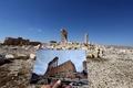 ISから奪還のパルミラ遺跡、破壊前の写真と比較