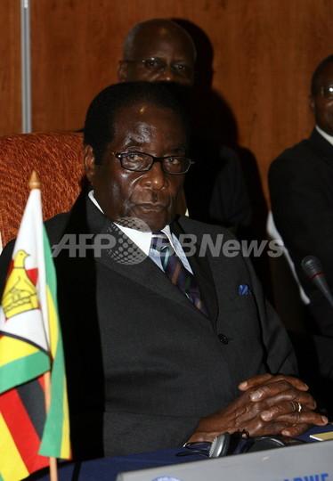 ジンバブエ連立交渉、野党党首不在で次週に延期