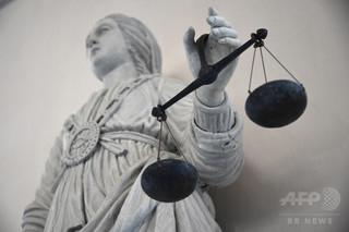 暴力夫を殺害した女性受刑者に恩赦、仏大統領