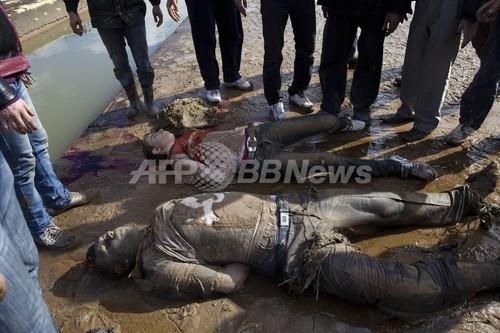 国際ニュース:AFPBB Newsシリア・アレッポの川から78人の処刑遺体、頭部に銃弾1発
