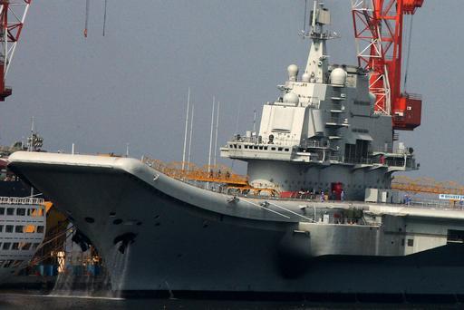 中国初の空母、試験航行は近隣国に対する心理戦か 専門家分析