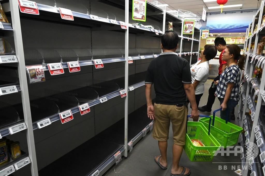 シンガポールで買いだめ騒動、新型ウイルスの警戒レベル引き上げで