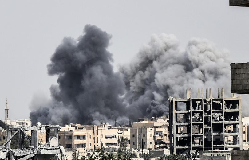 米支援のシリア部隊、IS「首都」の半分を制圧