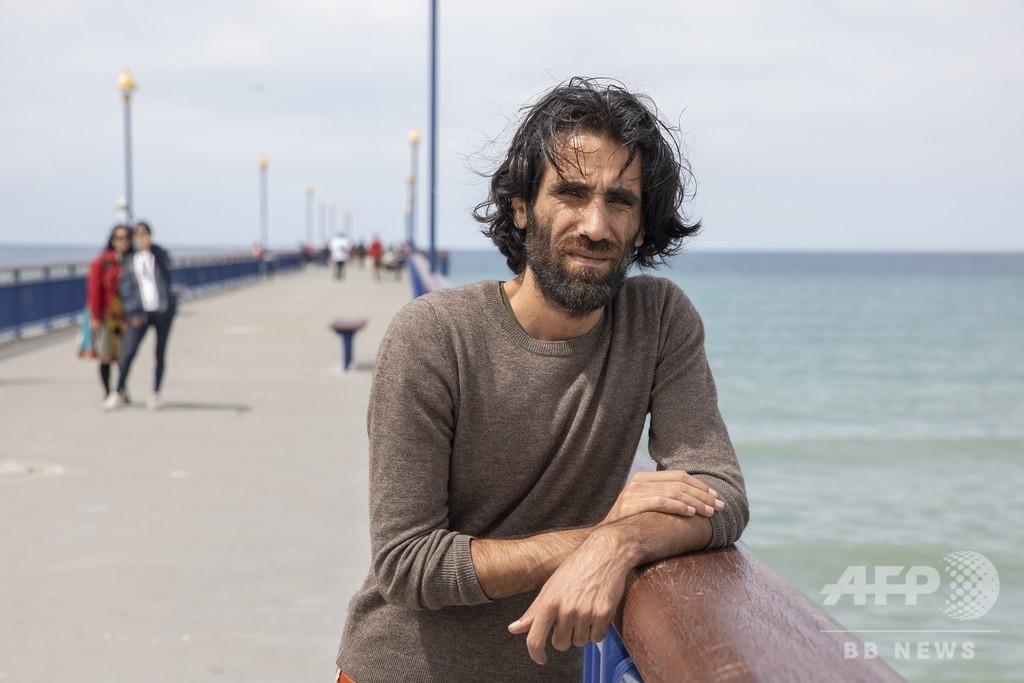 携帯電話での執筆作で文学賞受賞のクルド難民、NZが亡命許可