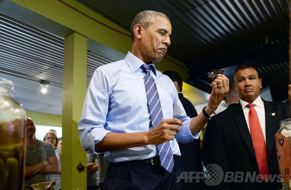オバマ米大統領、行列割り込みで予想外の大出費