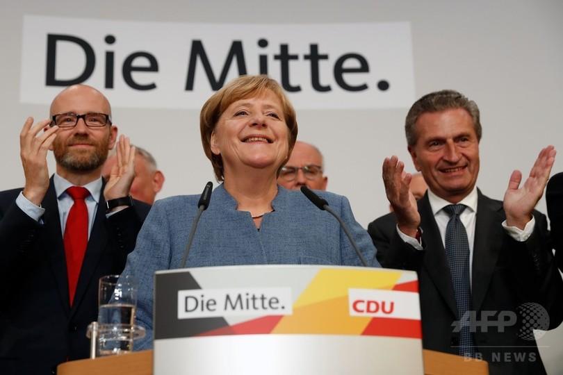 独下院選で与党勝利、メルケル首相4選へ 新興極右が第3党に