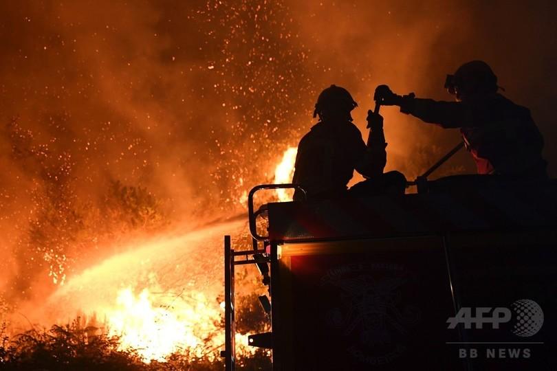 死者60人超のポルトガル森林火災、火の勢い食い止める