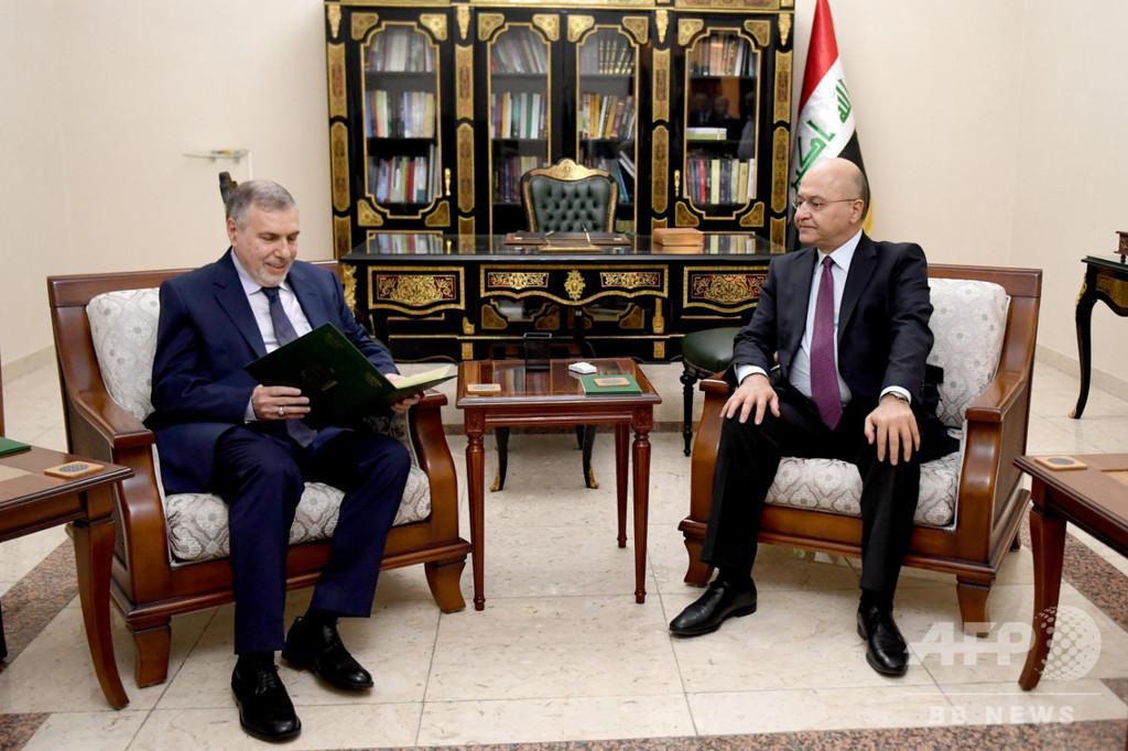 イラク新首相にアラウィ元通信相、反政府デモ続く
