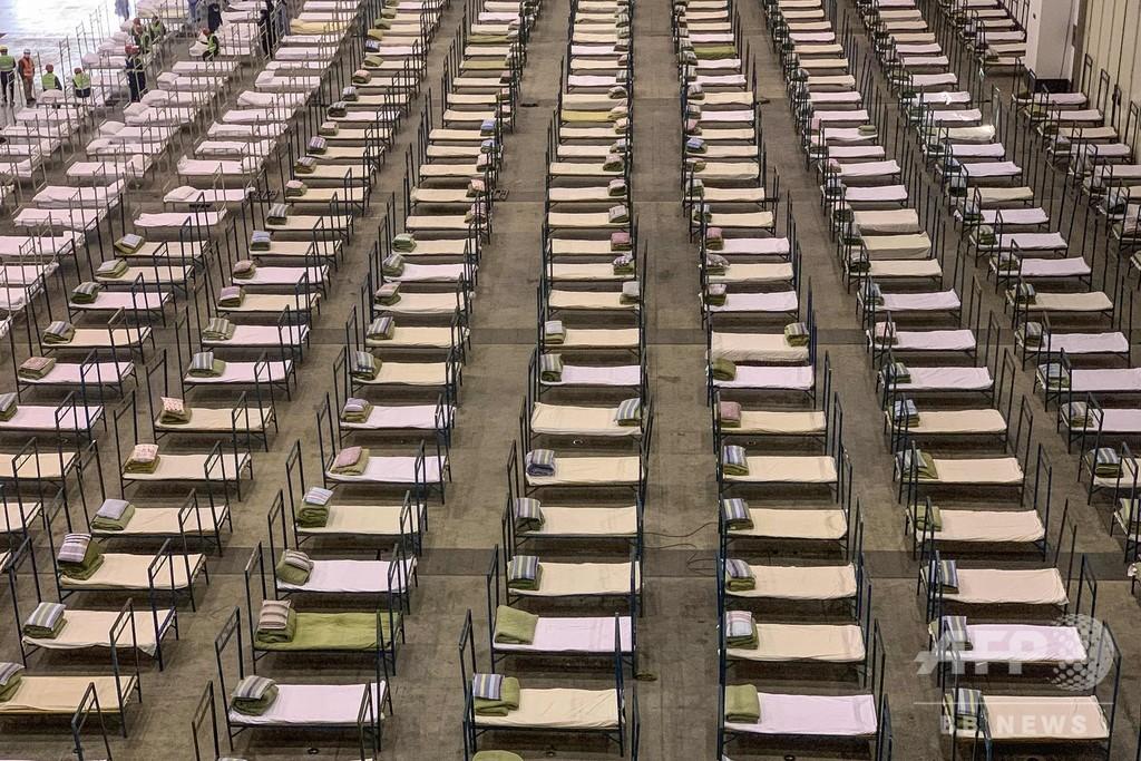 展示施設をベッド数千床の病院に改造、10日で建設の病院も稼働 中国
