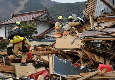 「我々はあきらめない」、大船渡の被災地で活動する米救助隊