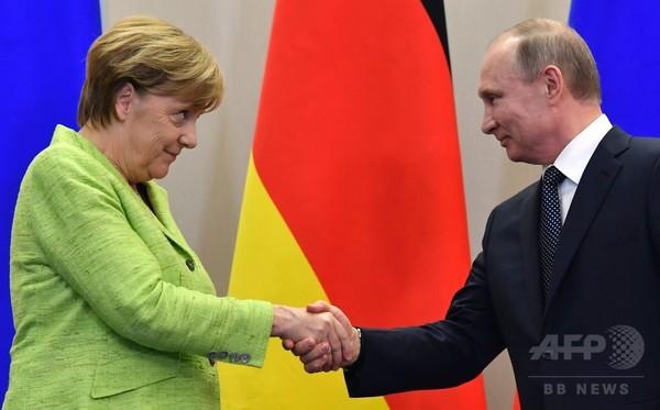 独ロ首脳が会談、ウクライナ問題や同性愛者迫害疑惑で対立