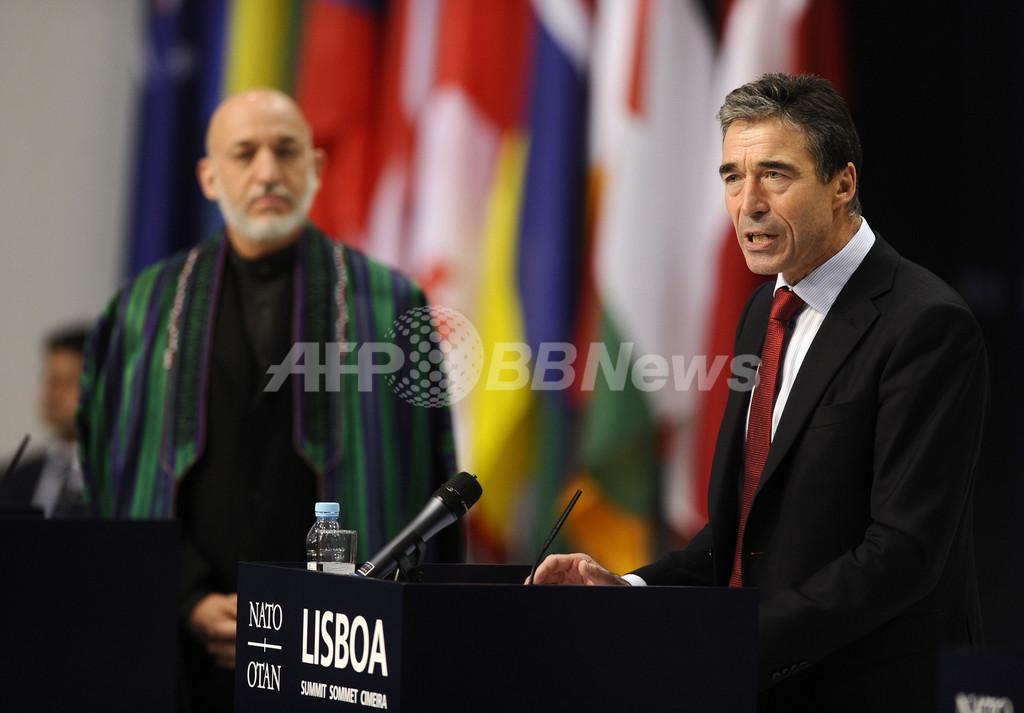14年末までのアフガン治安権限移譲で合意、NATO首脳会議