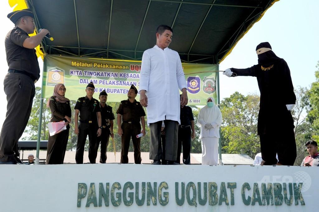 イスラム法のむち打ち刑、初めて仏教徒に執行 インドネシア