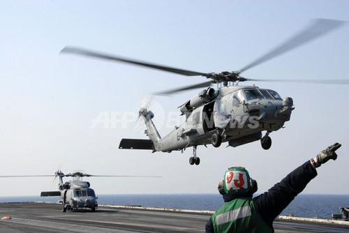 米第7艦隊、原発風下から離脱 放射線検出受け