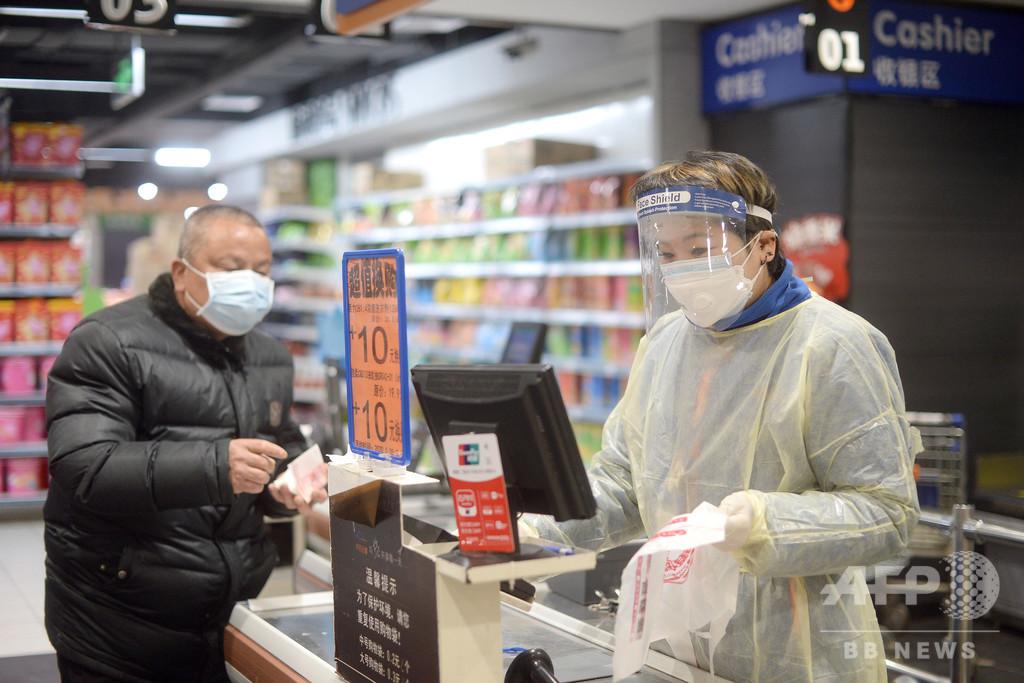 中国、ウイルス拡散防止で使用済み紙幣を消毒 最長2週間の隔離も