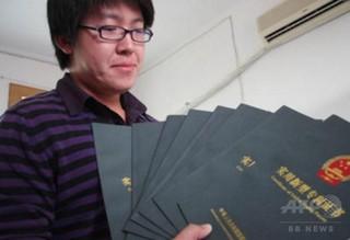 中国の大学院生、1年間で九つの発明特許 アイデアは常にメモ帳に