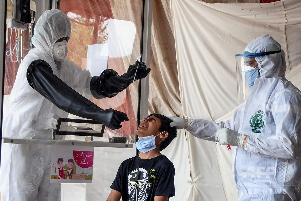 新型コロナ新規感染者、7月に入り急増 AFP集計