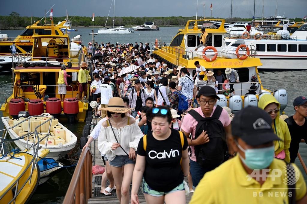 バリ島に足止めの中国人、休暇の延長喜び大半が帰国便に乗らず
