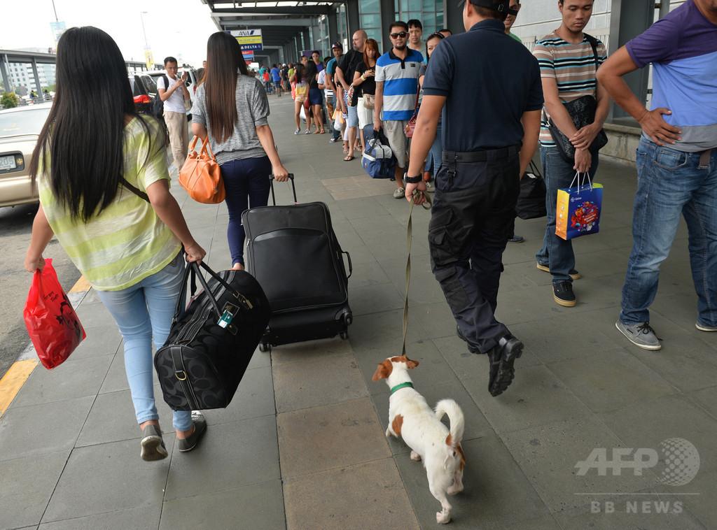 空港トイレで子犬水死、米女性を逮捕