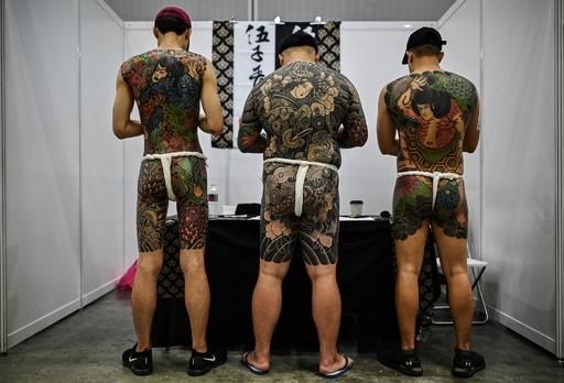 タトゥーイベントは「ポルノ」? 半裸姿の写真にマレーシア政府が猛批判