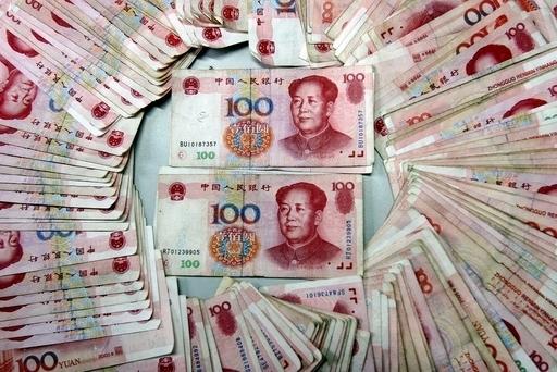 中国、人民元建て決済を試験導入へ 国際通貨めざす動きか