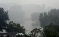 五輪まで1か月、大気汚染のスモッグでかすむ北京の紫禁城