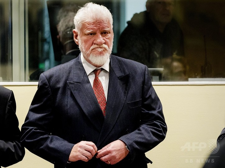旧ユーゴ戦犯、法廷で服毒自殺 ...