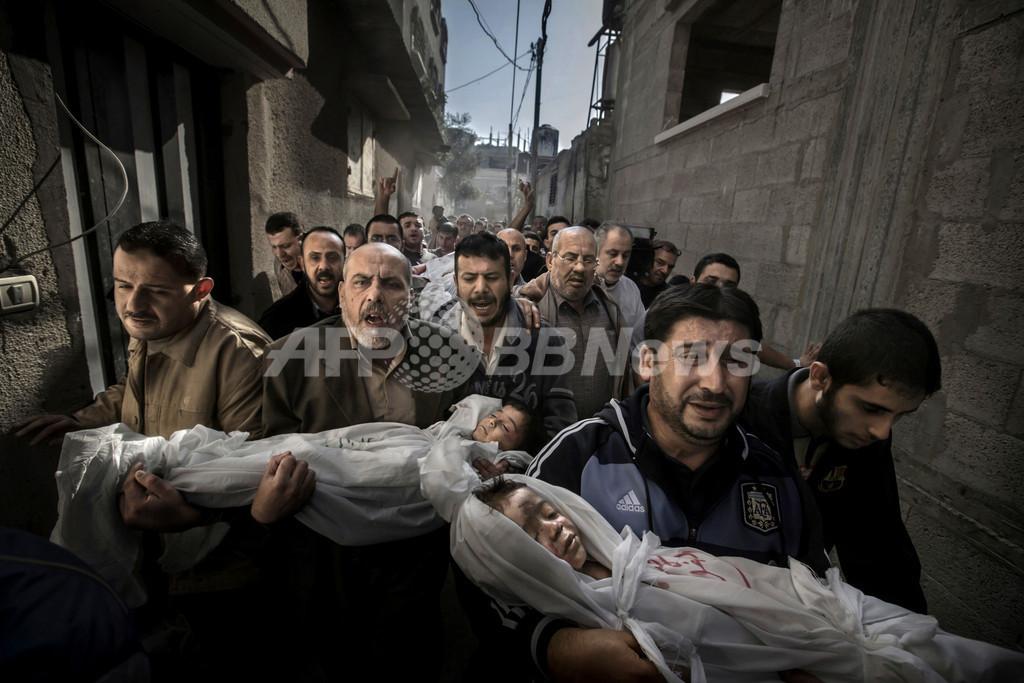 2013年世界報道写真大賞、「ガザの親子の葬列」に