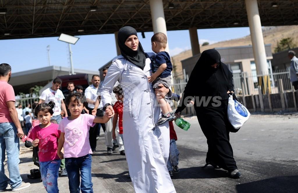 スウェーデン、亡命希望のシリア難民全員受け入れへ