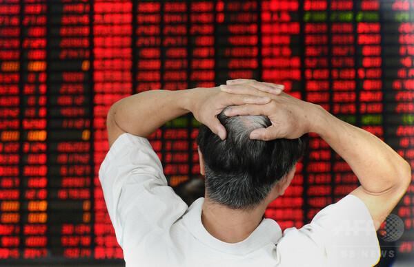 経済誌記者、中国株式市場混乱させたと「自供」 新華社