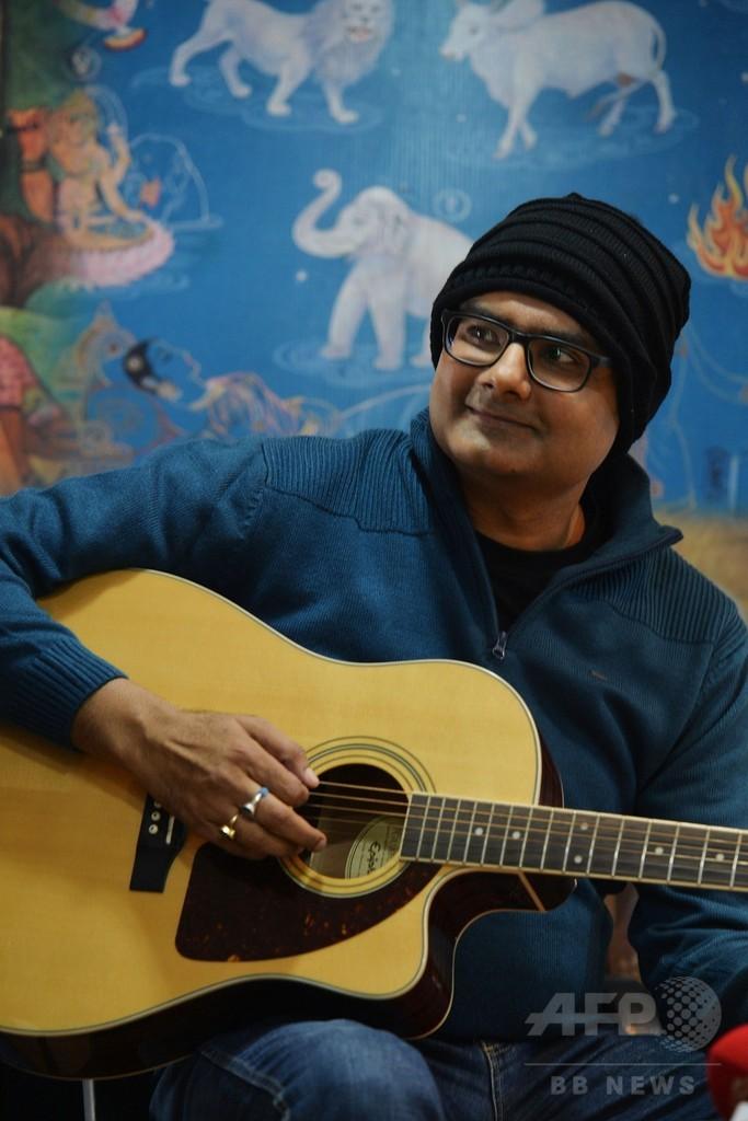 ギター弾きながら脳手術…インド人男性、ジストニア治癒