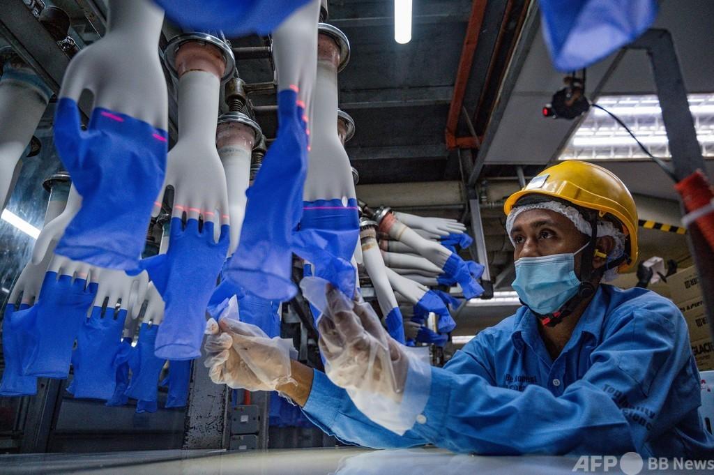 医療用手袋の世界大手、半数超の工場で操業停止 コロナ急増