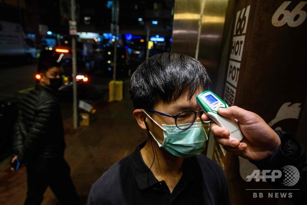 火鍋囲んだ親族10人が新型ウイルス集団感染、業界に打撃 香港