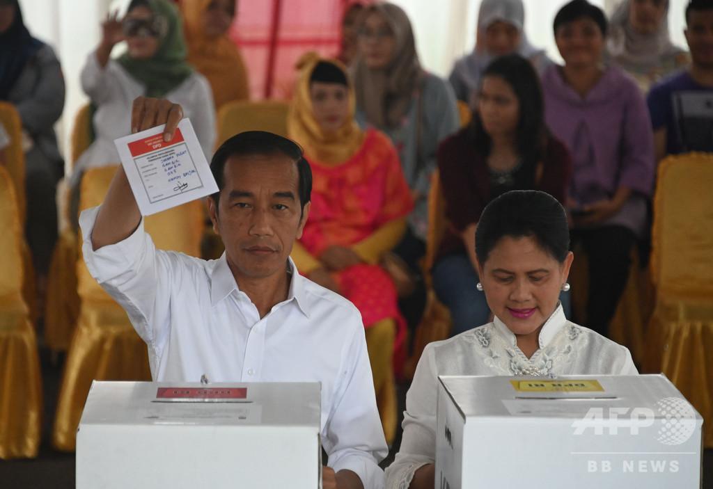 インドネシア大統領選の投票始まる、現職と元軍司令官の再戦