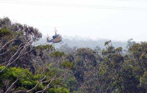 消火活動中のヘリが墜落 豪クイーンズランドの森林火災で