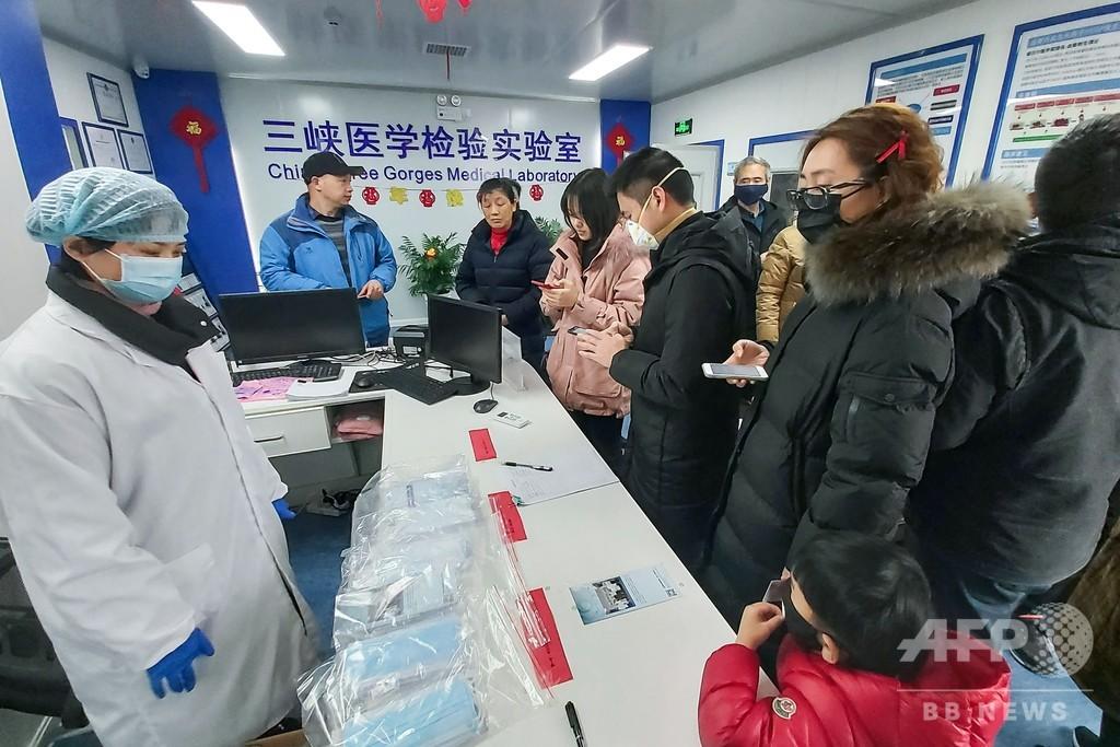 中国の新型コロナウイルス、死者25人に増加 感染者も830人に