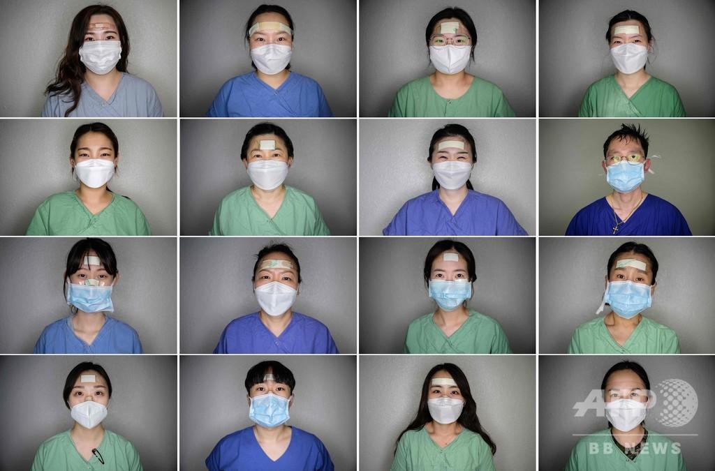 ばんそうこうは献身の印、韓国新型コロナ最前線の看護師ら