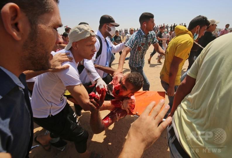 ガザでイスラエル軍が発砲、4人死亡 AFPカメラマンも撃たれ負傷