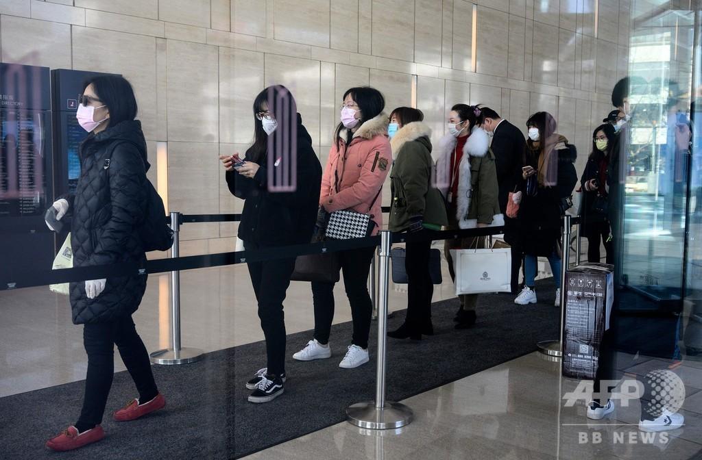 新型ウイルス、中国で死者908人・患者4万人超 企業活動再開