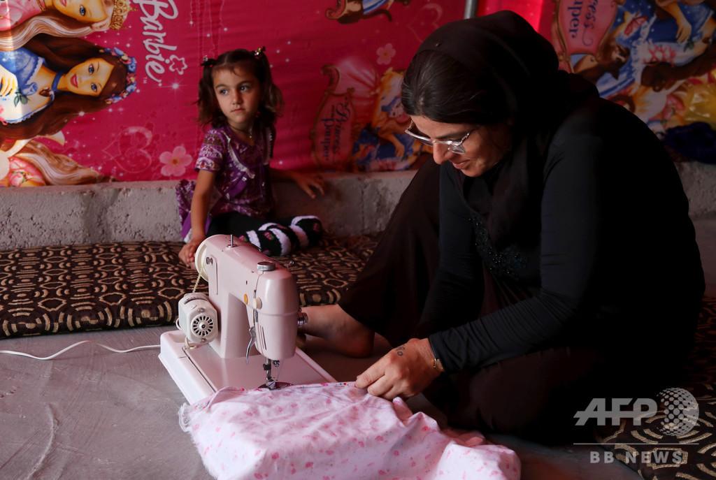 家計支える女性ヤジディー教徒たち、ISの暴虐で一家離散