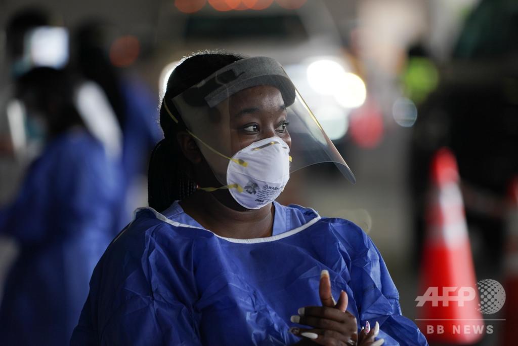 コロナ感染に「制度的差別」の影、医療者の防護具入手に差 研究