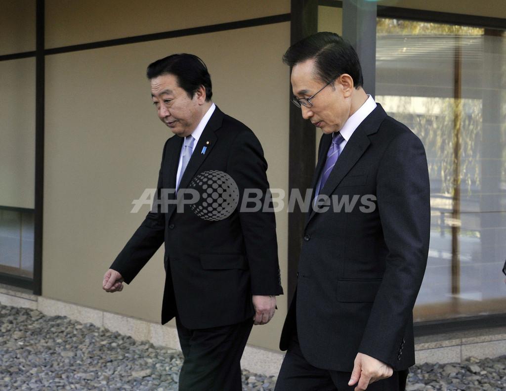 韓国大統領、「慰安婦問題の解決に勇気を」 日韓首脳会談