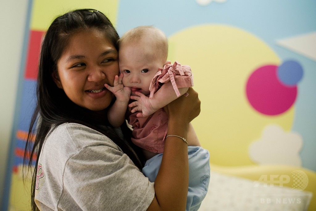 「ダウン症児拒否」は誤解、代理出産依頼の豪夫婦が反論