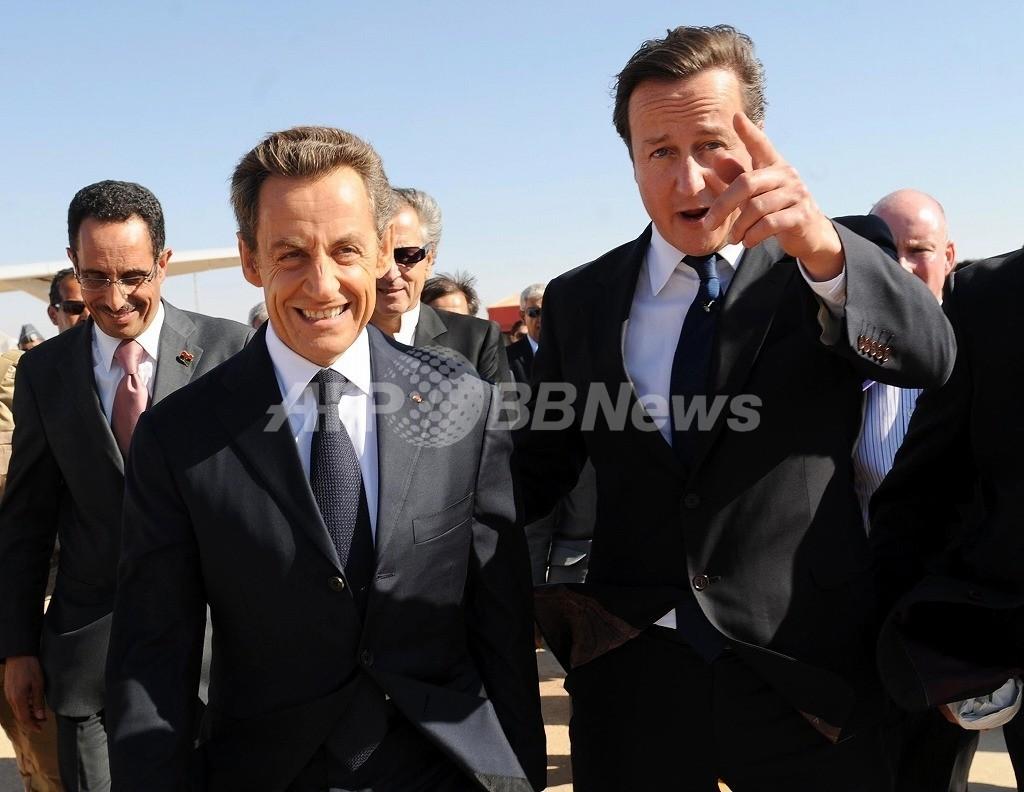 訪日中止しユーロ圏会議出席、英首相の「介入」にサルコジ氏「うんざりだ!」