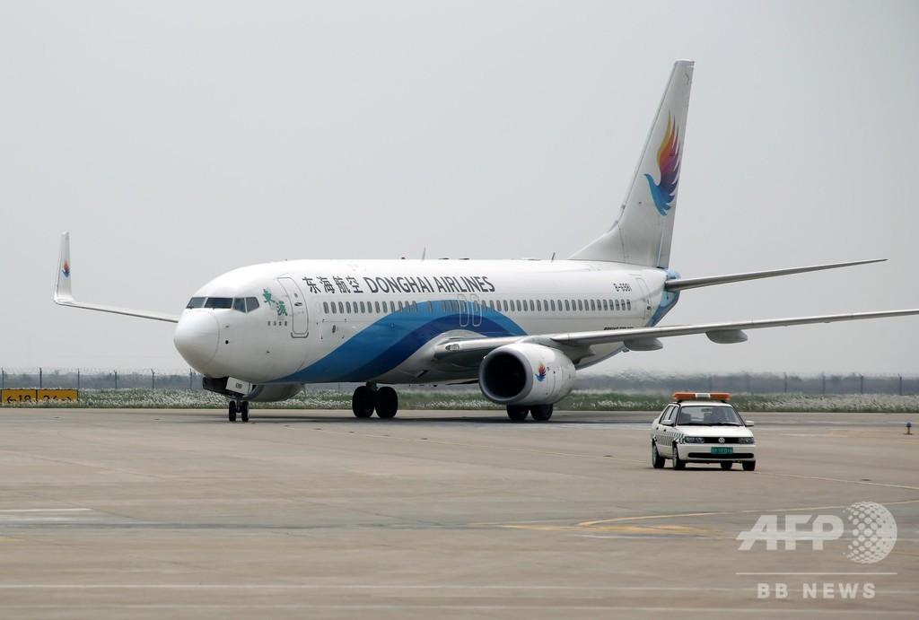 機長の妻を操縦室に乗せたまま飛行、搭乗券は未購入 中国・東海航空