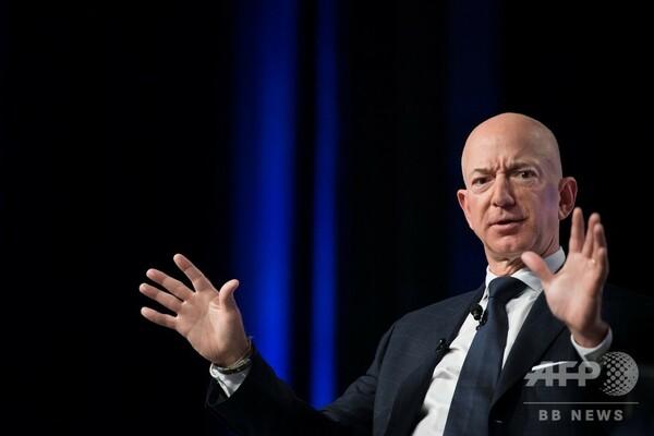 米アマゾン、最低時給15ドルに引き上げ 批判に対応