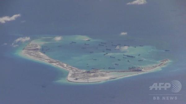 米軍偵察機「追い払った」、中国が勝利宣言 南シナ海の人工島問題